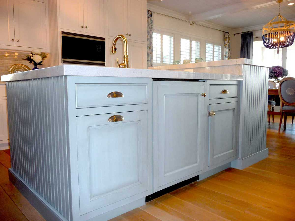 Baby blue cabinets complete island in center of a family's Bethany Beach, Delaware destination house.