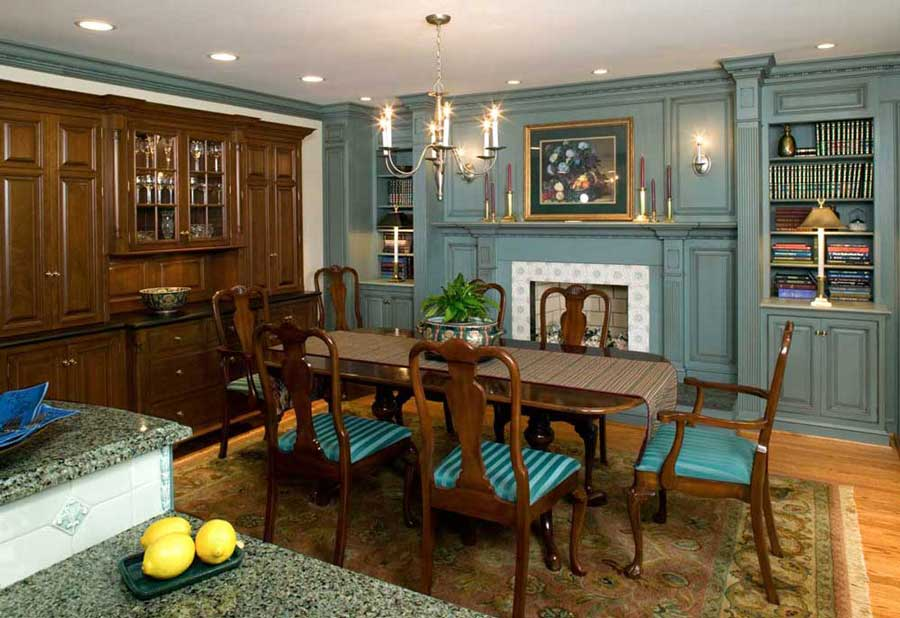 Blue Cabinetry With Dark Wood Cabinets For A Traditional Dining Room Connected To Kitchen