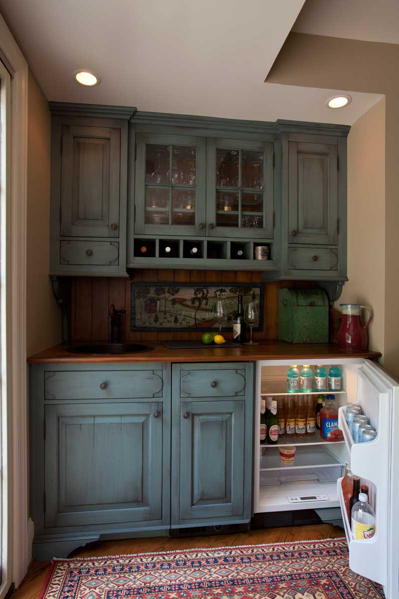 blue hutch design with an undercounter refrigerator in a traditional kitchen