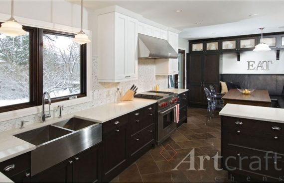 Artcraft kitchens transitional kitchen design with dark wood and white cabinetry with white countertops