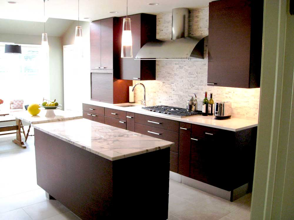 Marble Countertops With Dark Wood Cabinets And A Stainless Steel Range Hood  Creates A Contemporary Kitchen