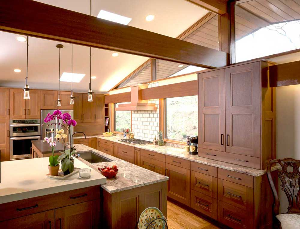 Modern Craftsman Kitchen Design with Typhoon Bordeaux Granite Countertops and Wood Ceiling Beams in Wilmington Delaware