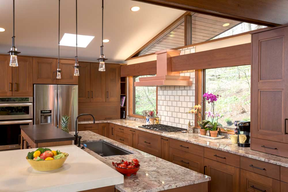 Modern Craftsman Kitchen Design with a Copper Range Hood and Stainless Steel Appliances in Wilmington Delaware