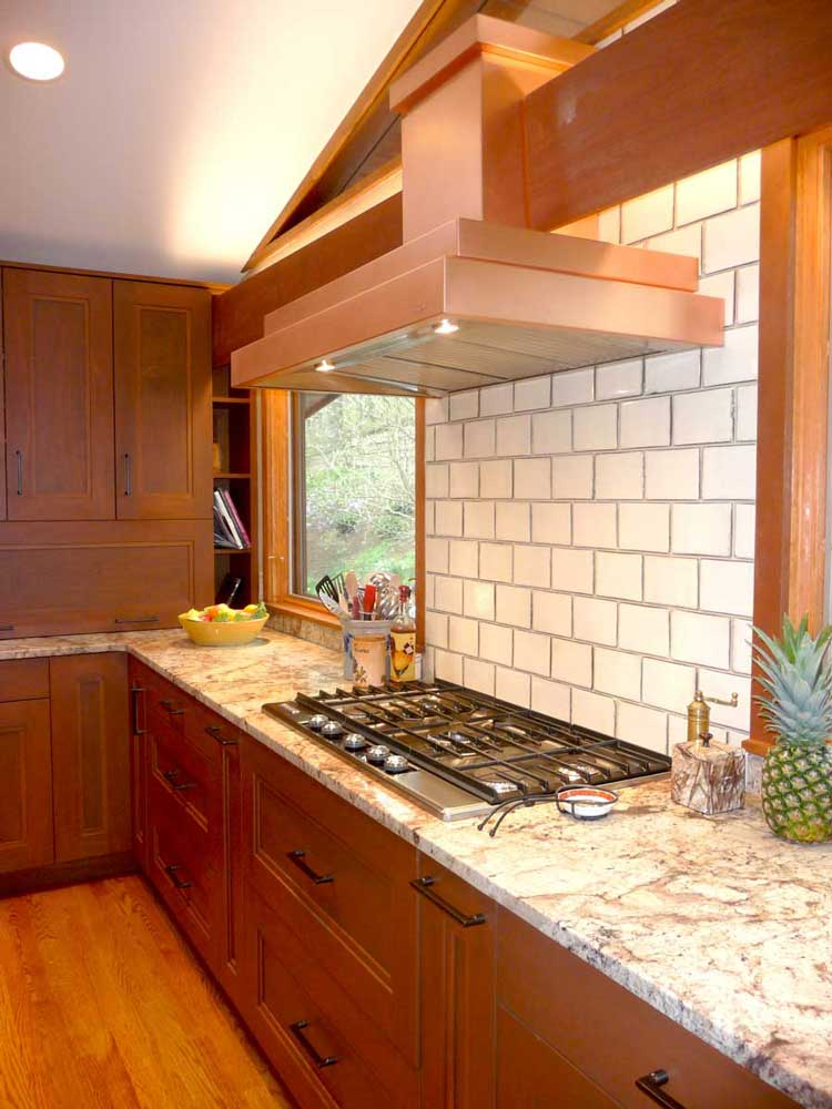 Modern Craftsman Kitchen with White Subway Tile and a Copper Range Hood Above the 5-Burner Stove