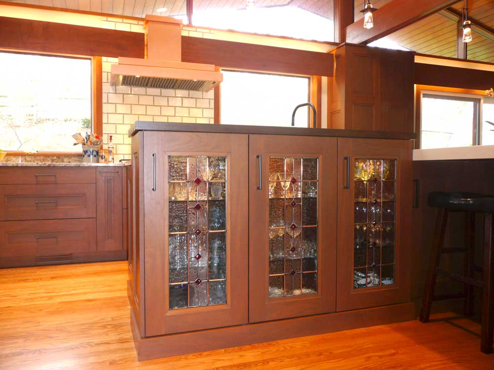 Modern Craftsman Kitchen with Mahogany Wood Cabinets and Detailed Glass Display Cabinets in Wilmington Delaware