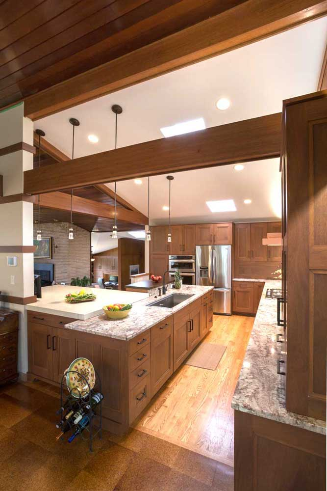 Modern Craftsman Kitchen with Typhoon Bordeaux Granite Countertops with a Raised PentalQuartz Chroma Botticino Countertop Island