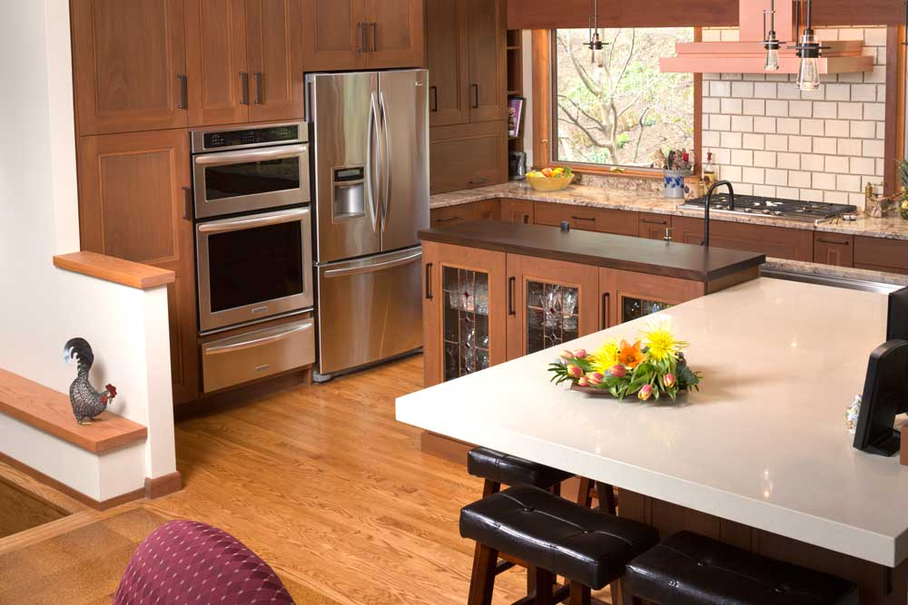 Modern Craftsman Kitchen Design with Mahogany Wood Cabinets and Stainless Steel Appliances and Subway Tile