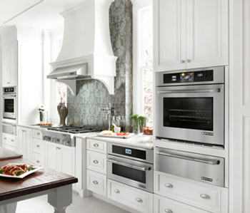 Kitchen with a jenn-air wall oven with a warming drawer and a jenn-air stainless-steel microwave drawer