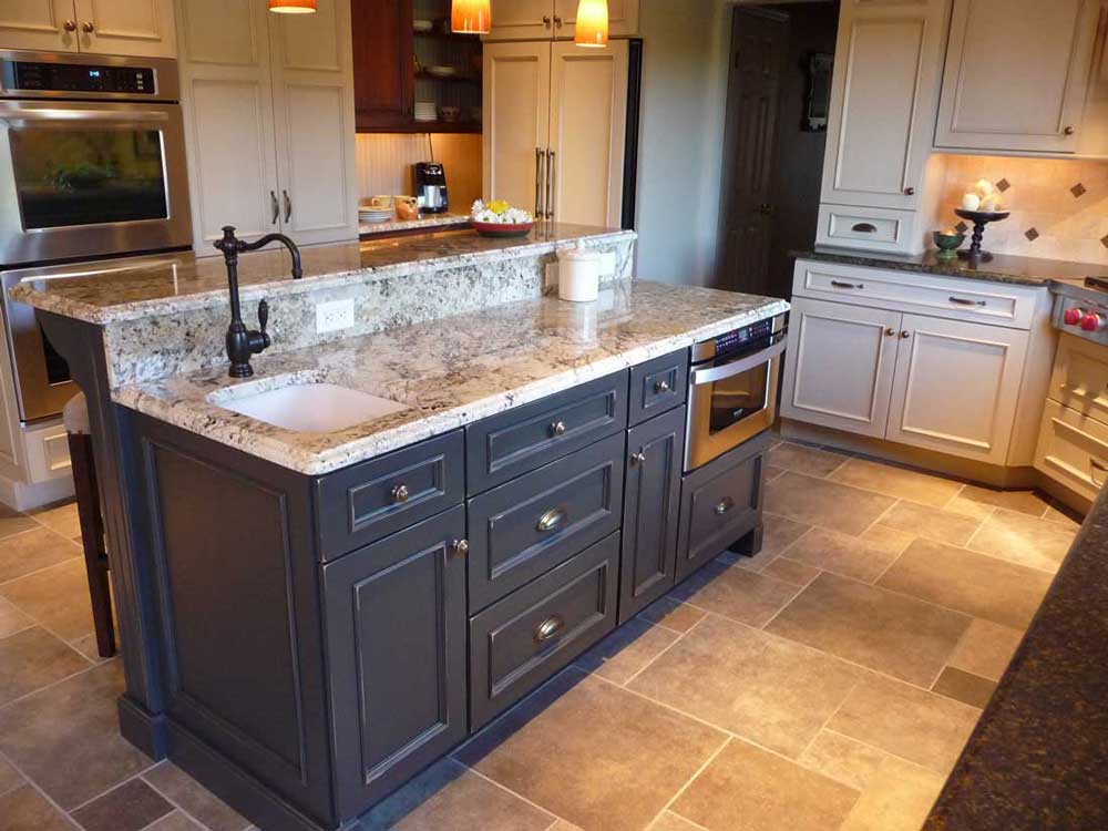 Traditional Kitchen Island with Blue Cabinetry and a Prep Sink and a Stainless Steel Microwave