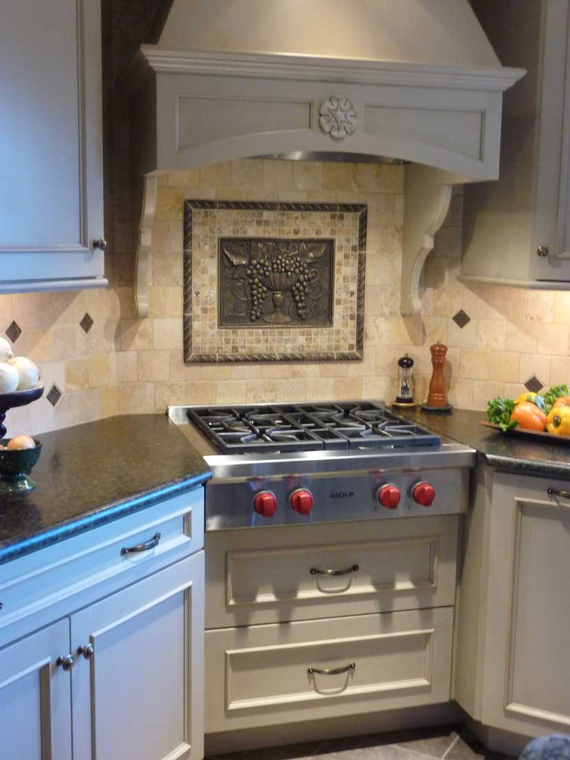 SubZero and Wolf 4-Burner Cook Top with Red Knobs in Stainless Steel with Custom Range hood