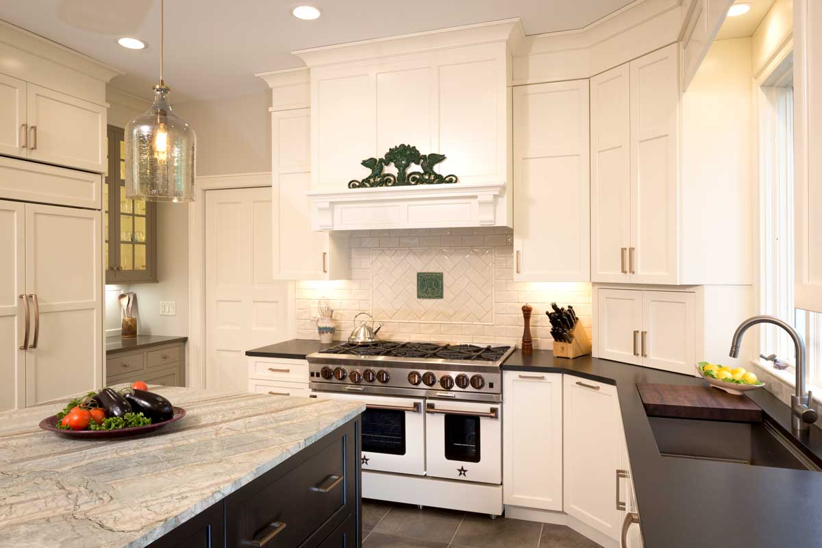 Transitional Kitchen with White Cabinetry and kitchen copper accents and an absolute black granite perimeter countertop