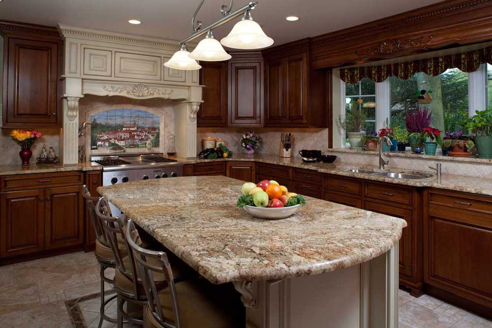 L-shaped traditional kitchen with multi-colored kitchen tile flooring and custom island cherry cabinets.