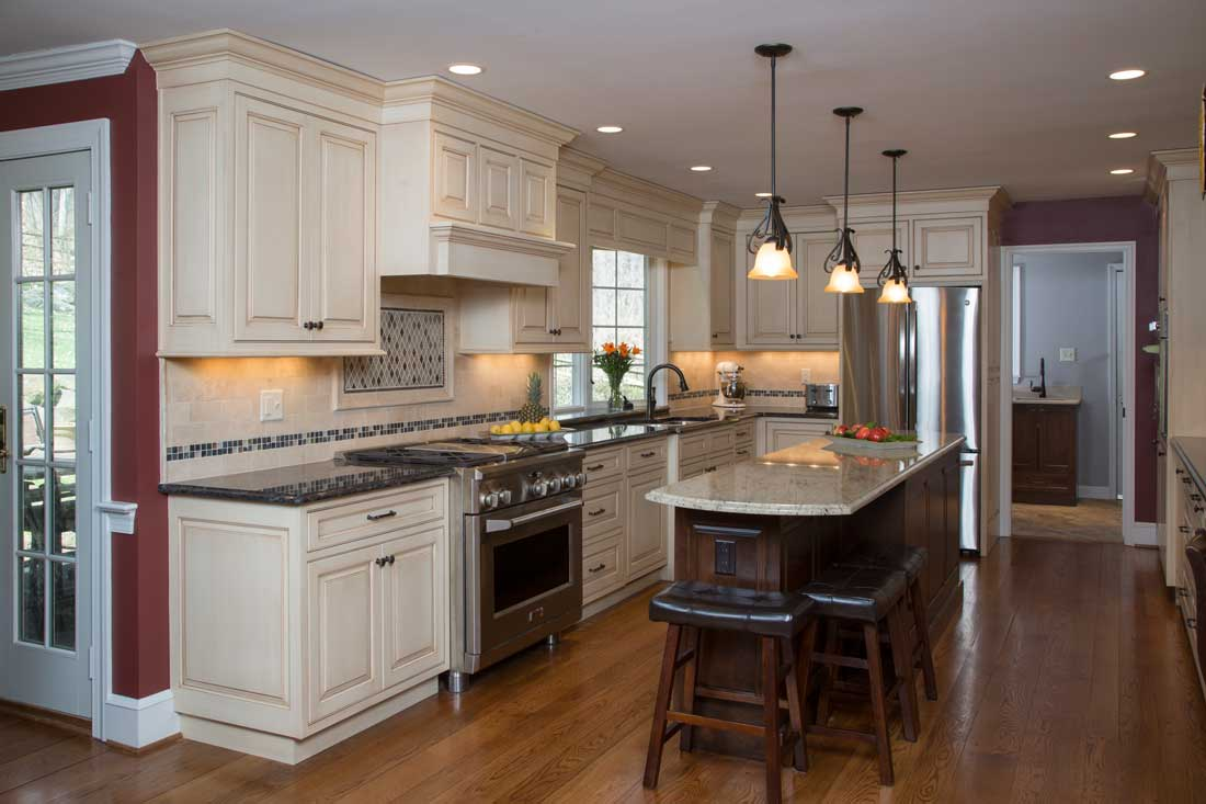Color Statement Kitchen with a mosaic tile backsplash and off white cabinetry in a traditional kitchen