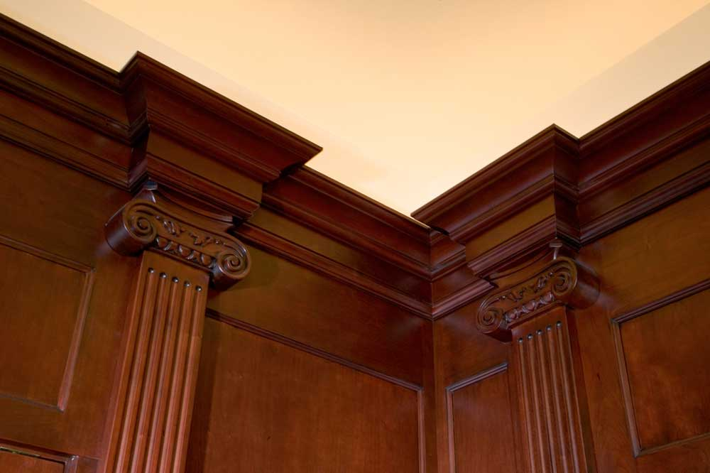 Ceiling-high dark wood crown molding with a white ceiling for a formal master bath design