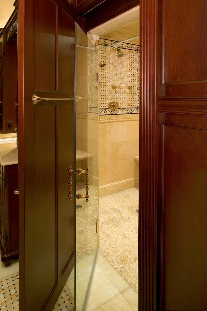 Private shower room with a glass door in a large formal master bath design in Delaware