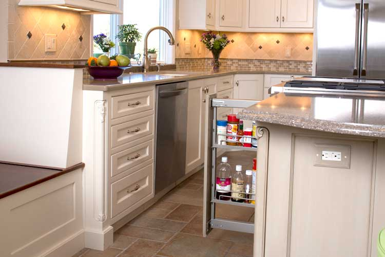 Pull out spice rack for a traditional kitchen with warm neutral colors and white cabinetry