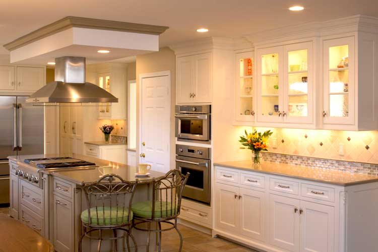 Neutral colors used throughout this traditional kitchen with white cabinetry and German glass mullion doors