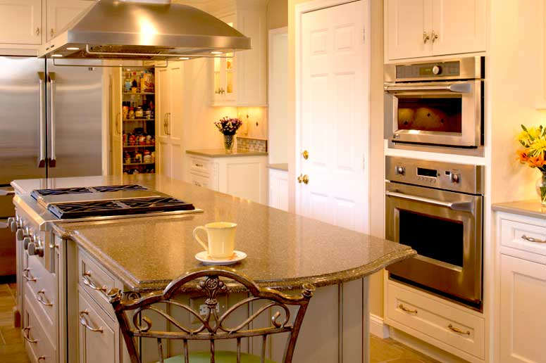 Warm neutral colors with white perimeter kitchen cabinetry and grey kitchen island cabinets