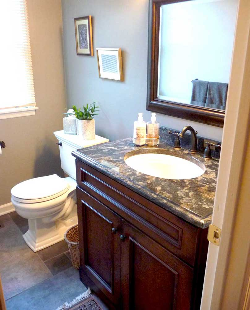 Single vanity with a sink and a mirror for a traditional powder room design in Delaware