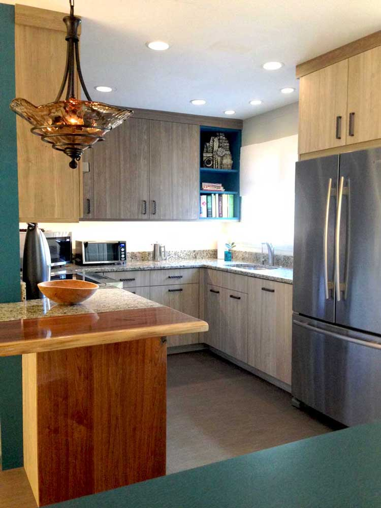 Transitional small kitchen design with two different cabinet finishes and stainless-steel appliances