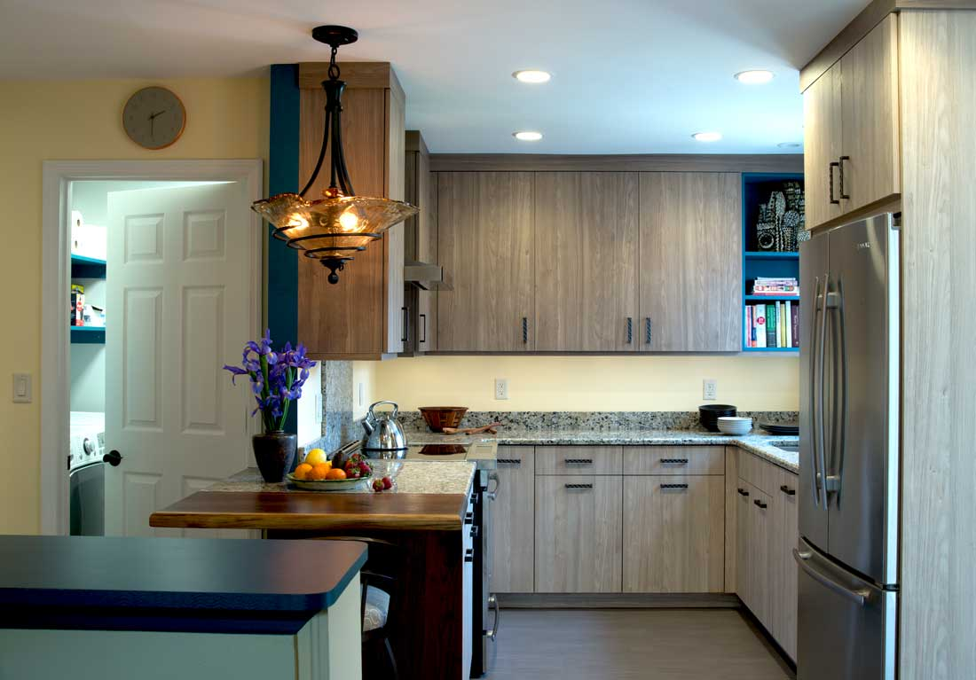Transitional small kitchen design with ceiling high cabinets in two different finishes and stainless-steel appliances