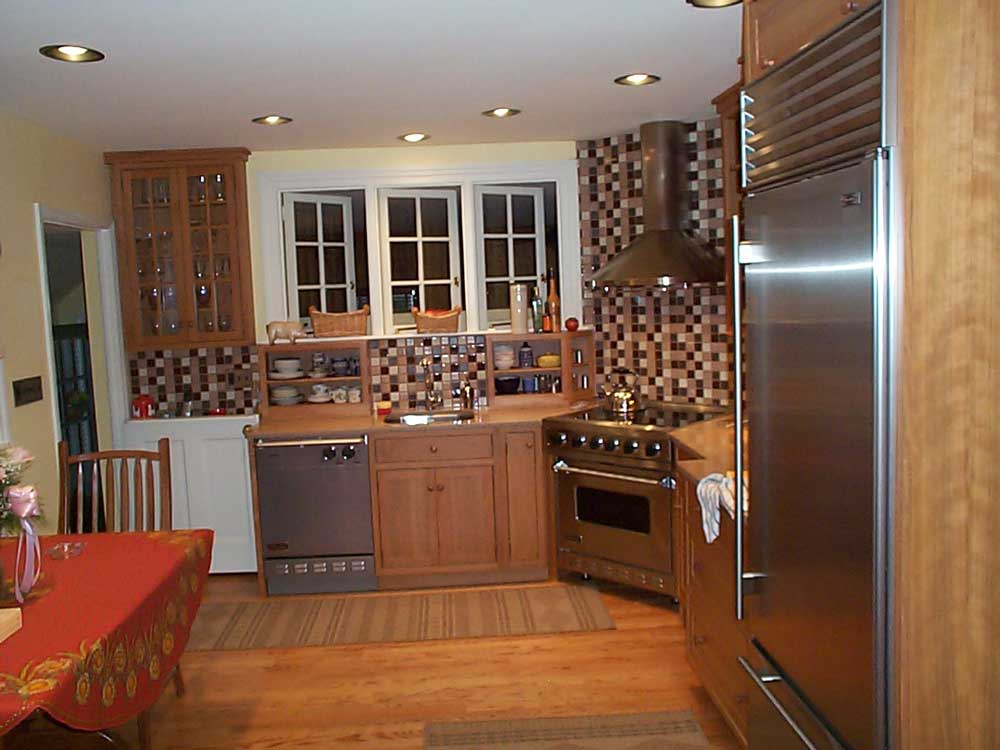Stainless steel appliances add a sleek touch design of the kitchen with a unique backsplash.