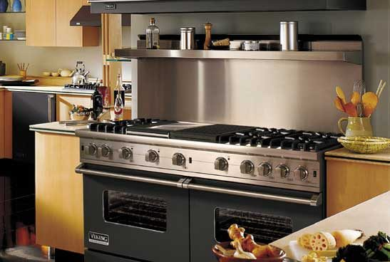 two Viking five burner ranges in a dark gray color with stainless-steel burner knobs and a spice shelf