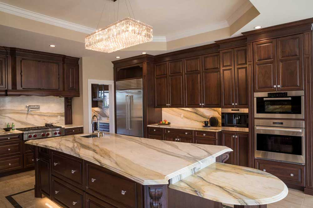 cocoa walnut kitchen with dark wood cabinetry and white countertops and island for a traditional kitchen