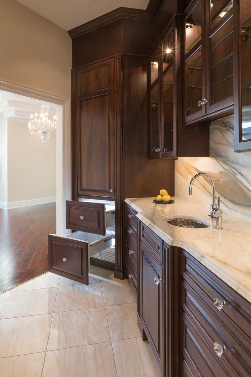 Butler's Pantry Area in a Traditional Cocoa Walnut Kitchen New Construction Design
