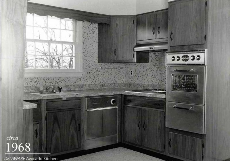 Vintage Black and White Kitchen Built in 1968 with a Wall Oven, a Dishwasher and Backsplash