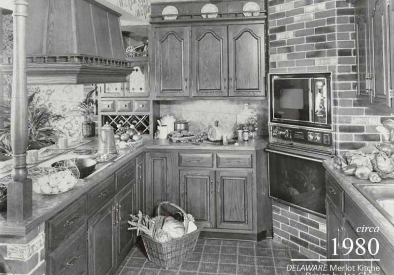 Patterned tile, an opulent range hood, and wine storage display the refinement of the vintage kitchen