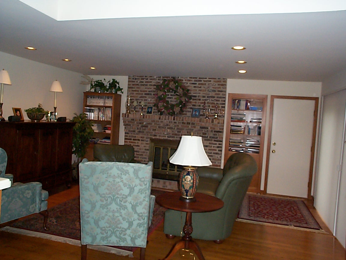 Brick Fireplace In Outdated Living Room Before Renovation