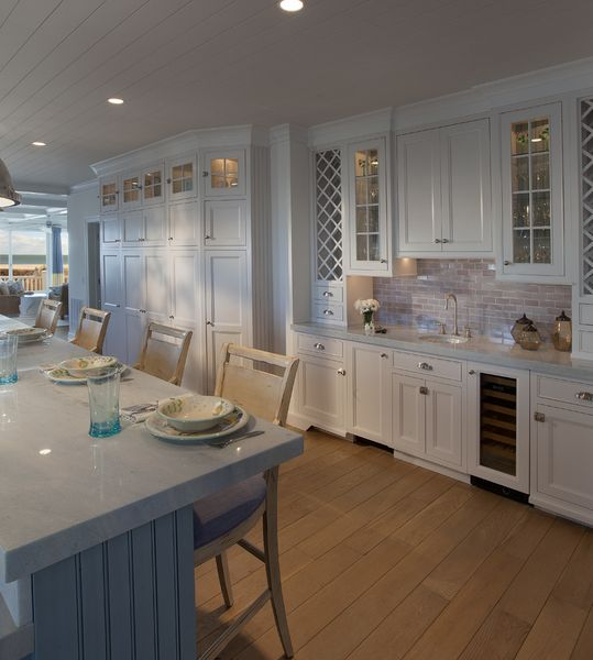 Spacious and sleek Blue Celeste Countertop dining area above baby blue cabinets on kitchen island.