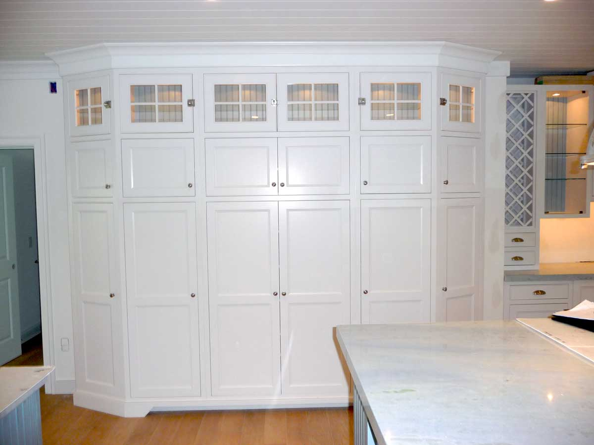 An expansive area of wall cabinetry near baby blue cabinets give homeowners as much storage as possible.