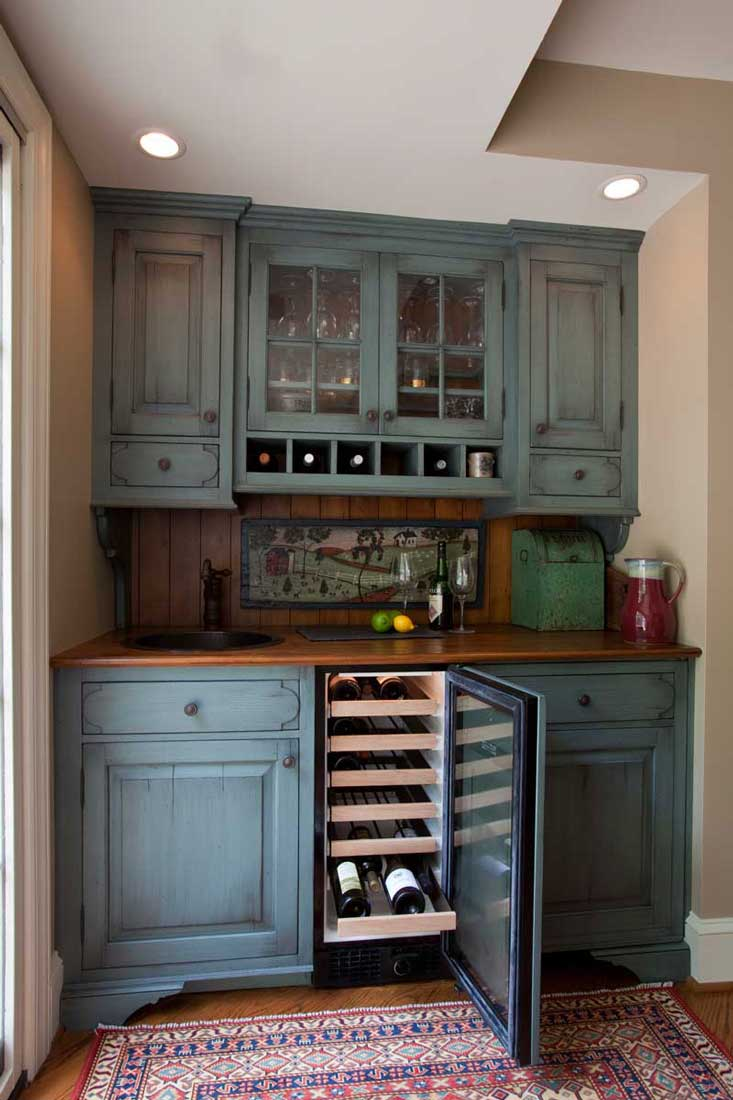 blue hutch with an undercounter wine fridge in a traditional kitchen