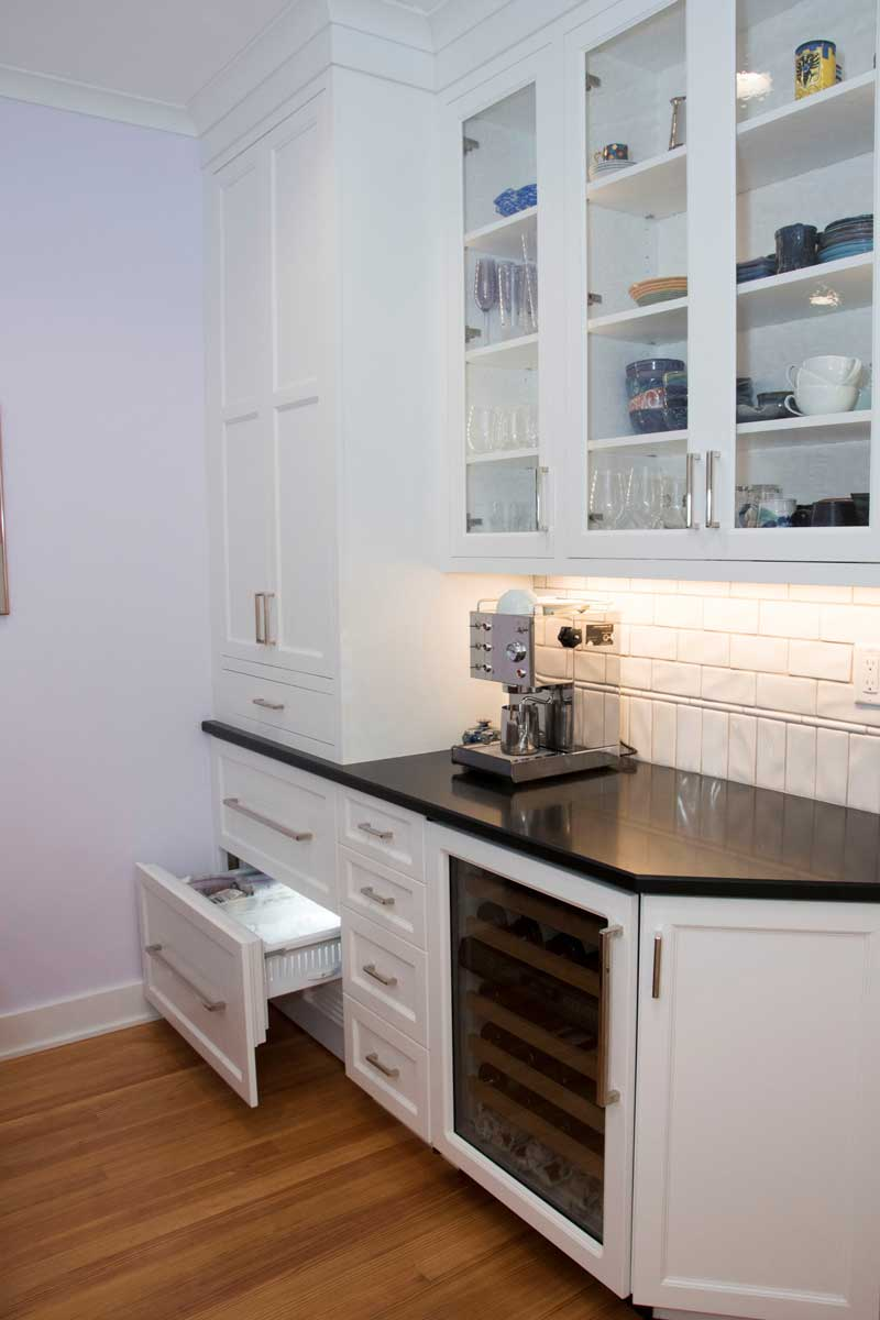 SubZero Freezer Drawers with a Wine Fridge for a Kitchen Bar with a Blue Kitchen Stove
