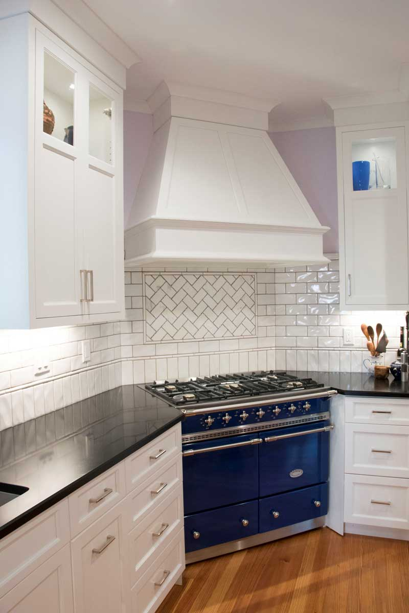 White kitchen cabinets with a lacanche cluny range and a best hood insert