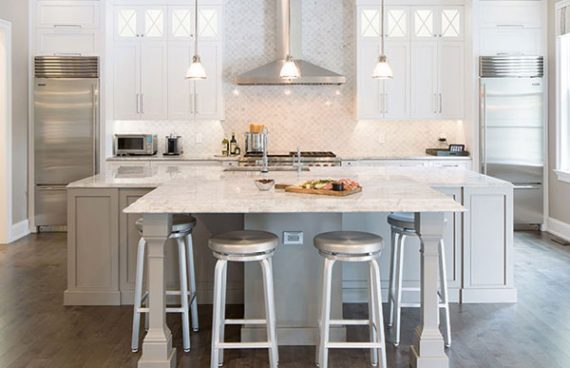 Plain and Fancy white custom cabinetry with gray custom kitchen island cabinets with kitchen island seating
