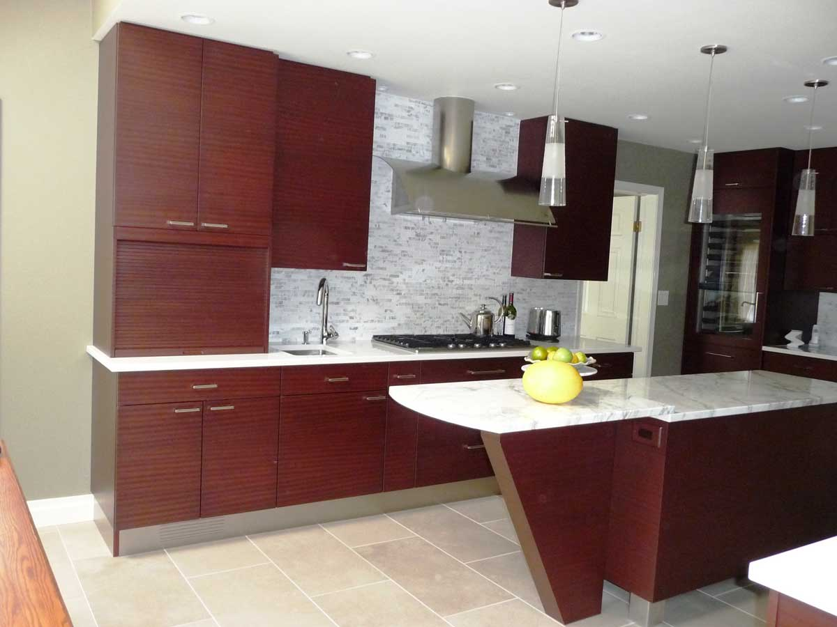 contemporary kitchen design with dark wood cabinets and marble countertops create the perfect entertainment space