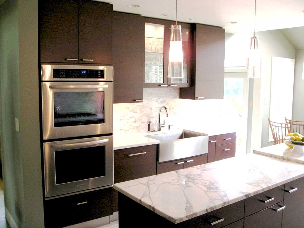 Contemporary Kitchen with Stainless Steel Ovens and a Stainless Steel Farmhouse Sink With a Tile Backsplash