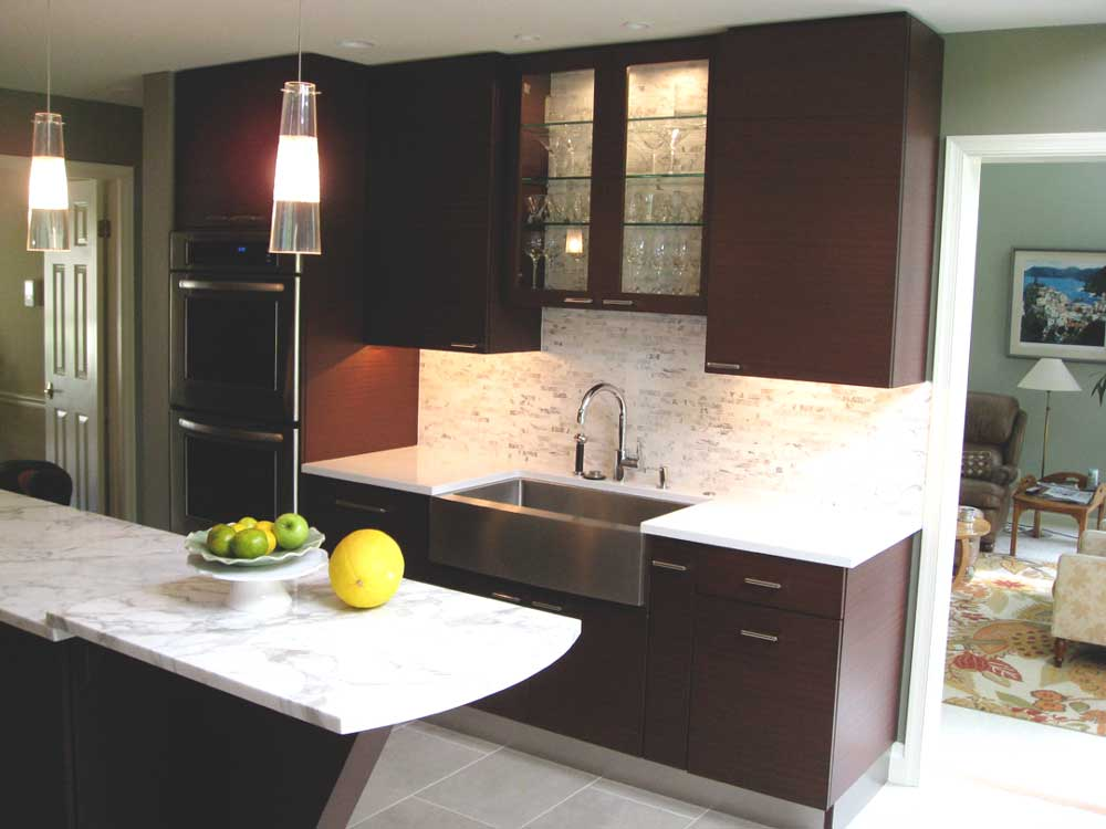 Contemporary Kitchen Design with Dark Wood Cabinets and White Countertops with a Stainless Steel Farmhouse Sink