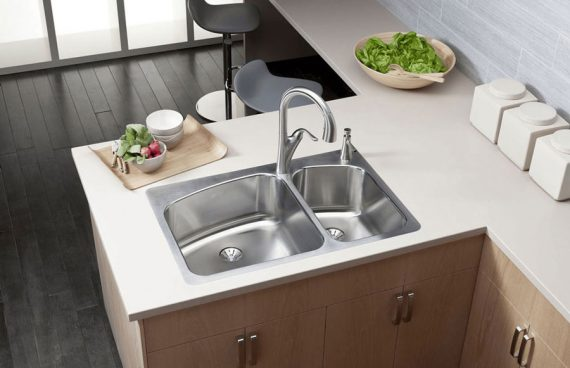 Elkay double-bowl kitchen sink in stainless steel with one faucet for a contemporary kitchen design