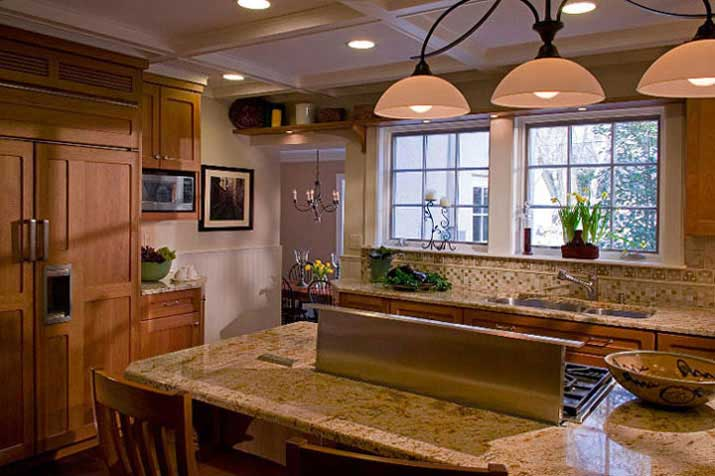 Wolf range is located on kitchen island for easy access and close to Custom Green Painted Hutch