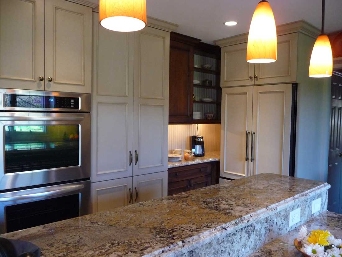Taupe granite with an ogee edge profile kitchen island countertop with a food prep sink
