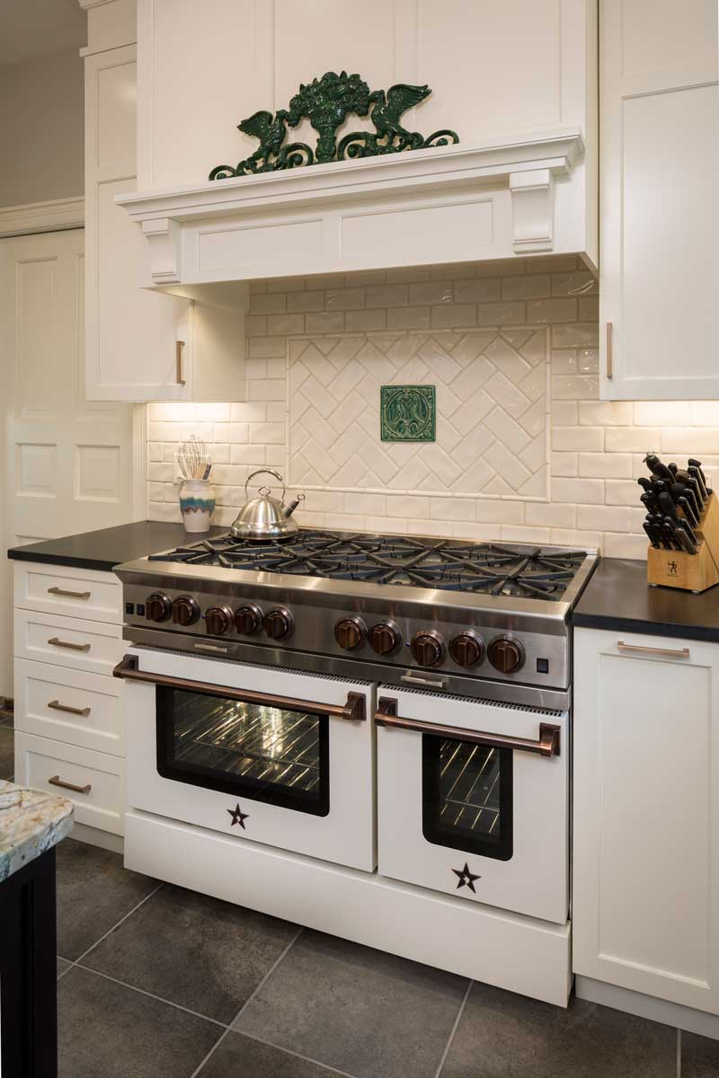 blue star range in custom cream color with copper knobs and pulls with best hood insert