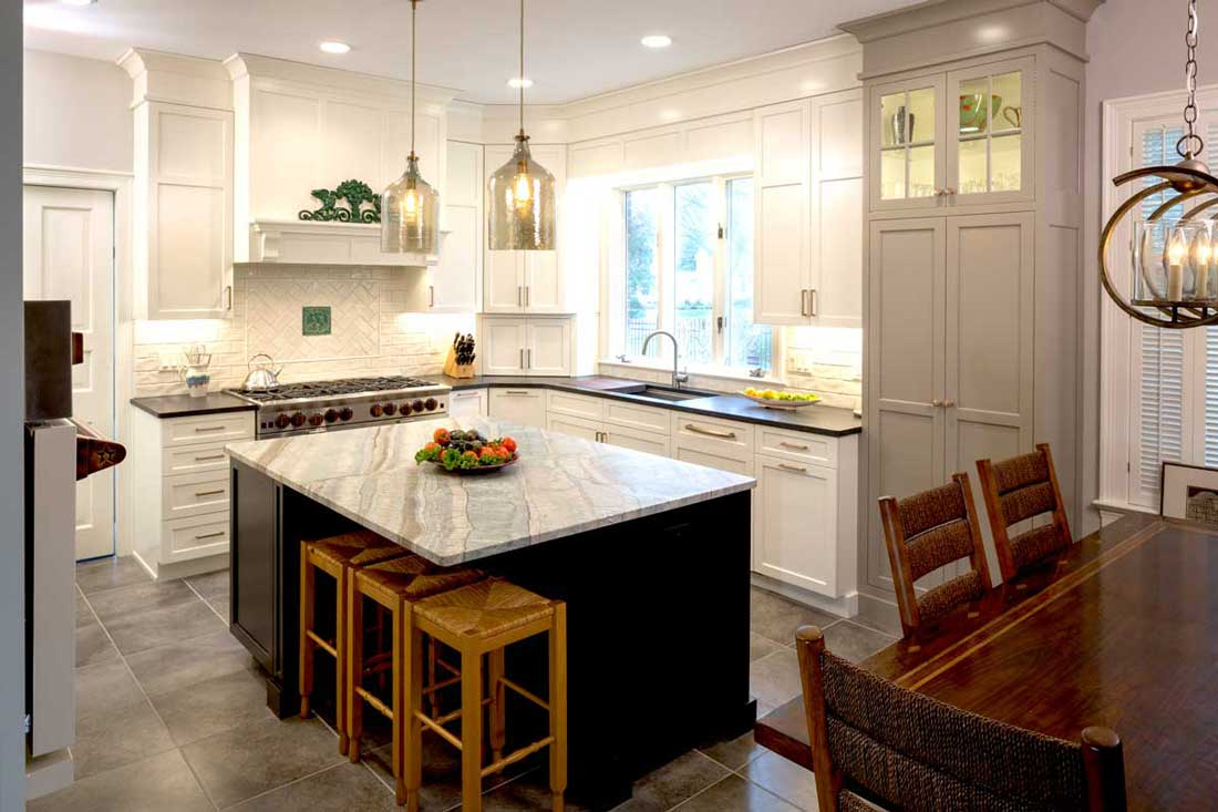 Transitional Kitchen with Copper Accents and a Dark Kitchen island with seating and two hanging lights