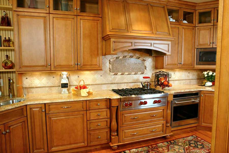 A high-end Wolf gas range is the focal point of the Traditional Maple Kitchen