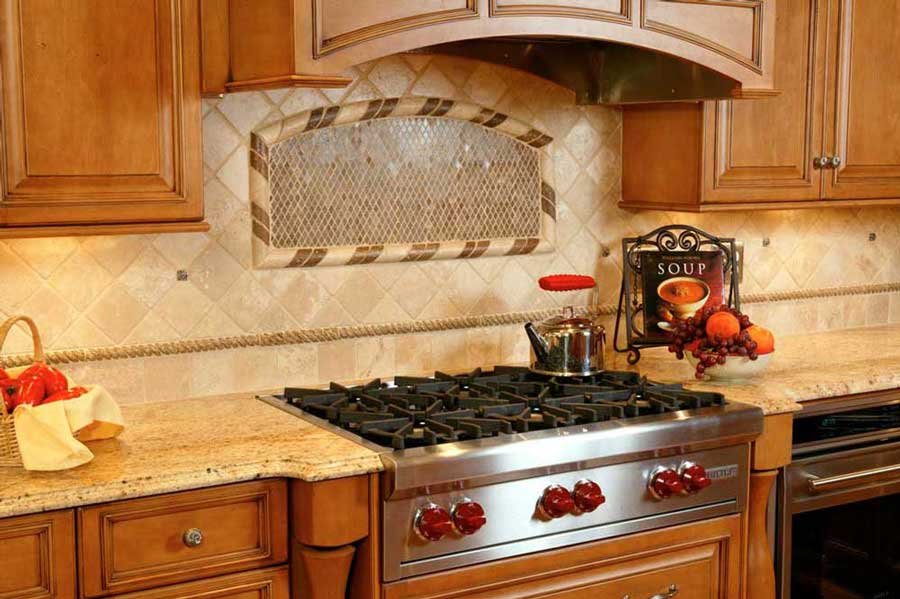 Light-colored Kitchen tile backsplash adds warmth to the design of the Traditional Maple Kitchen