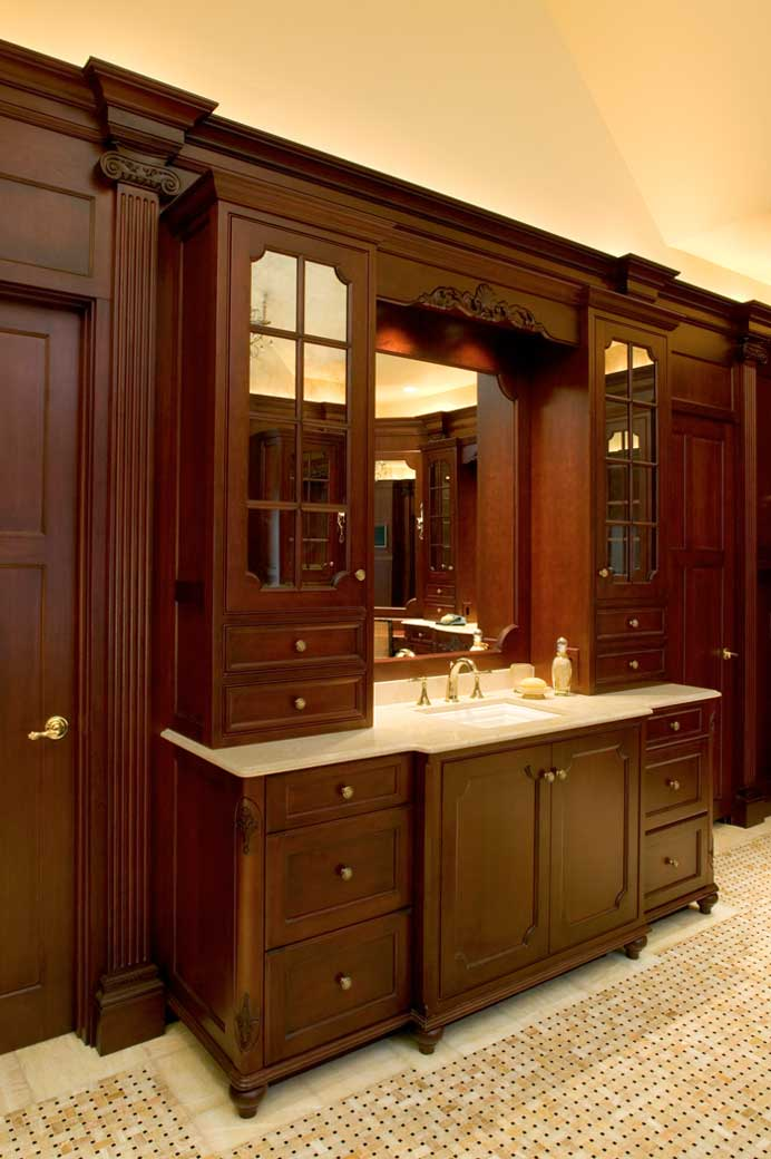 large vanity with a sink and a mirror and storage cabinets for a formal master bath