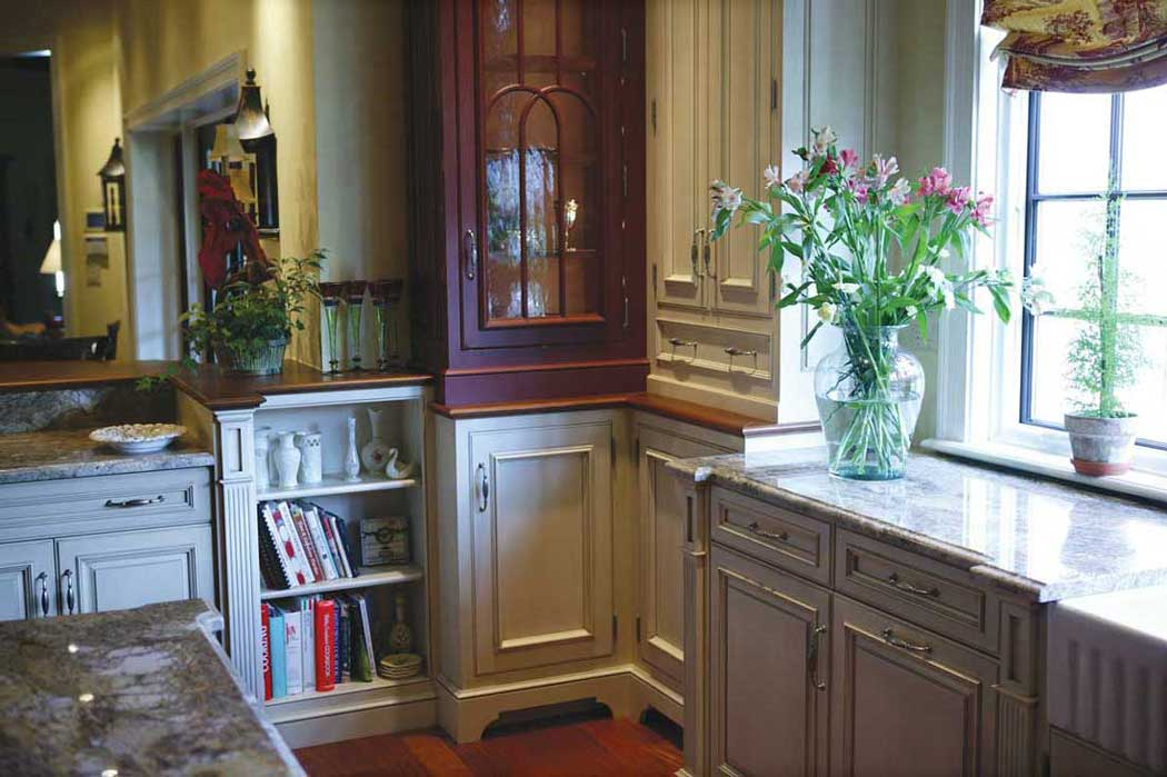 Combining Kitchen Cabinet Colors in Traditional Kitchen elevate the character in a Giorgi custom design.
